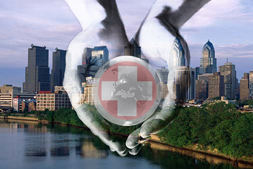 Philadelphia Skyline with Cupped Hans in front holding a first aid cross